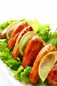 stock photo of roast chicken  - roasted chicken wings with salad - JPG