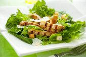 image of caesar salad  - Chicken Caesar salad  on the white plate - JPG