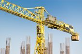 image of construction crane  - yellow construction crane on blue sky - JPG
