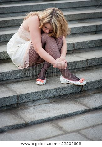 Sad Lonely Girl Sitting