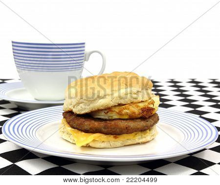 Breakfast Sandwich With Coffee On Checkerboard Cloth