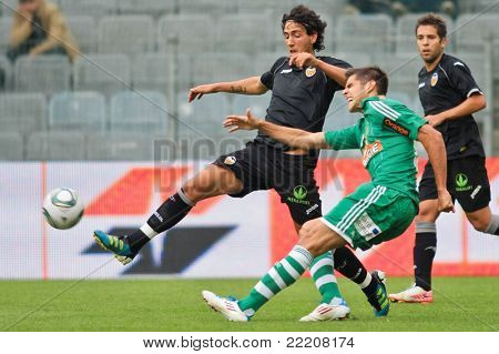 VIENNA,  AUSTRIA - JULY 26: Daniel Parejo Munoz (No. 18, Valencia) and Deni Alar (No. 33, Rapid) fight for the ball during the friendly soccer game on July 26, 2011 in Vienna, Austria. SK Rapid wins 4:1.