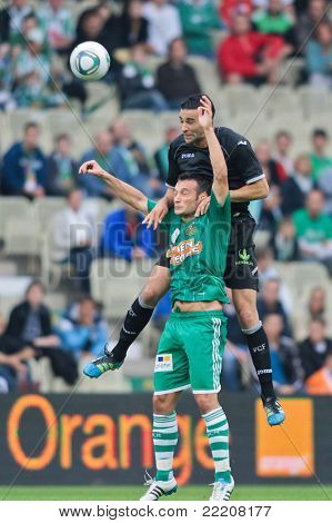 VIENNA,  AUSTRIA - JULY 26: Hamdi Salihi (No. 9, Rapid) and Adil Rami (No. 4, Valencia) fight for the ball during the friendly soccer game on July 26, 2011 in Vienna, Austria. SK Rapid wins 4:1.