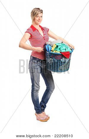 Full length portrait of a young woman holding a laundry basket isolated against white background