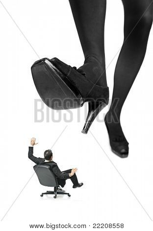 A giant foot about to squish a businessman in a chair isolated on white background