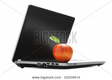 Apple with green leaf on a laptop