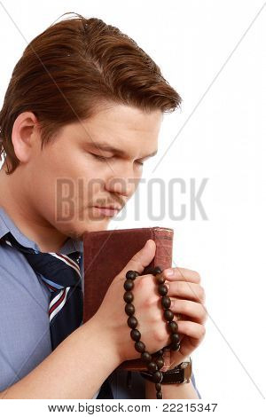 A praying man, isolated on white background