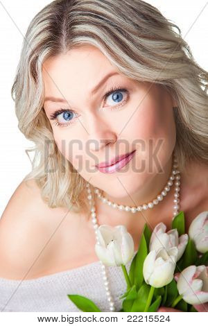 Close-up portrait of blonde woman with tulipson isolated white