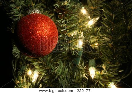 Red Ornament In Tree With Lights