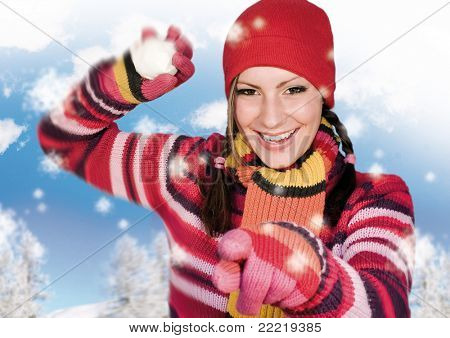 Girl in winter clothing throwing a snowball. keyword for this collection is: snowmakers77