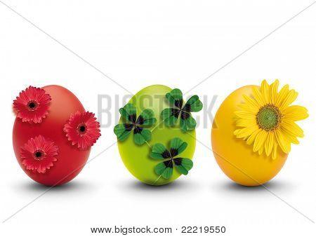 drie gekleurde eieren met natuur-decoratie