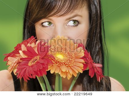 woman with dark hair hiding behind flowers