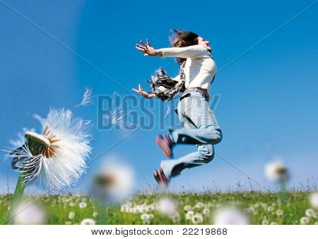 girl running in a meadow with dandelions