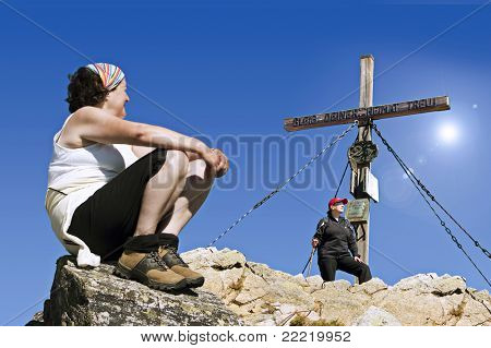 two women on the top of a mountain