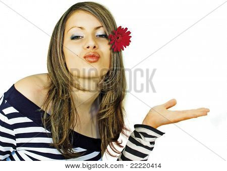 girl with red flower in her hair holding nothing in her hand