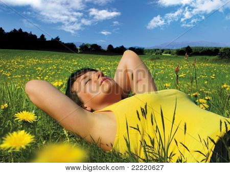 girl lying in a meadow enjoying the sun