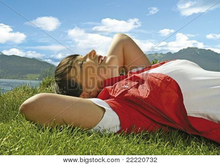 girl enjoying the sun by a beautiful lakeside. More pictures of her in my portfolio.