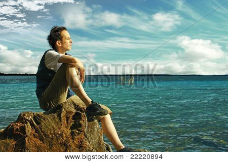 A man beside a lake looks into the distance. unique keyword for this collection is: lake77