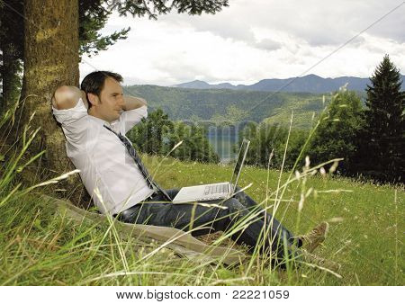 businessman working and relaxing in nature. Unique keyword for this collection: naturebusiness77