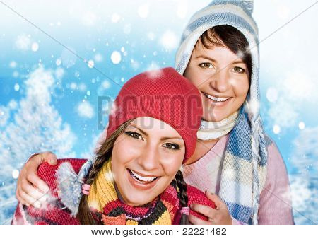 two girls in winter clothes having fun together.  keyword for this collection is: snowmakers77