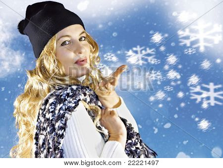 Blond girl is blowing snowflakes. keyword for this collection is: snowmakers77