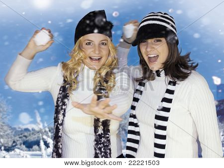 Two girls having fun in a snowy landscape. keyword for this collection is: snowmakers77