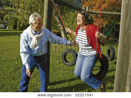 attractive married mature couple having fun in the park. keyword for this collection is