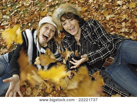 "two cute girls having fun on an autumn-day. keyword for this collection is ""autumn77"""