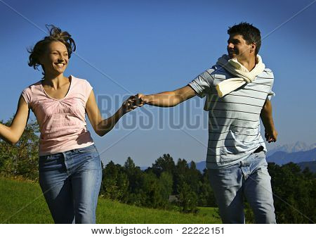 young playful couple on a summerday.