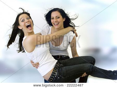 two pretty girls having fun together
