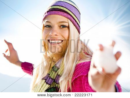 young blond girl with snowball