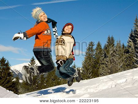 young boys having fun in winter landscape