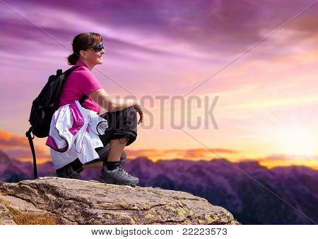 woman on the top of a high mountain