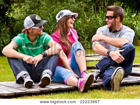 three teenager spending leisure together