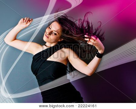 young woman dancing and listening to the music