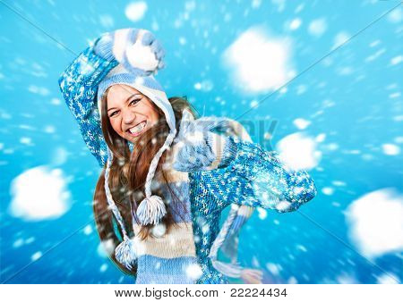 pretty girl throwing a snowball