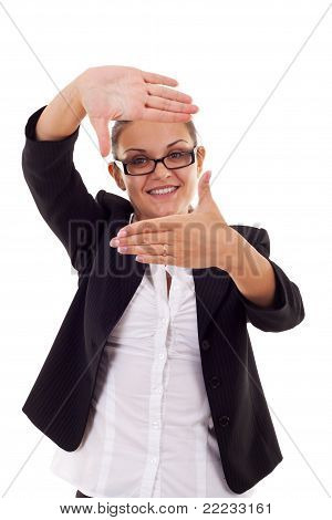 Business Woman Looks Through A Hand Frame
