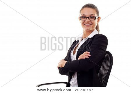 Business Woman Sitting In Office Chair With Arms Crossed
