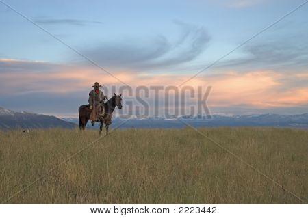 Cowboy On Ridge At Dawn