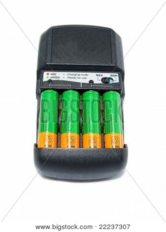 Charger With Batteries Isolated On White