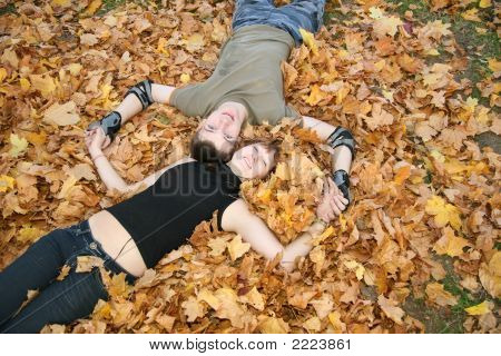 Young Couple Lies On Yellow Leaves 2