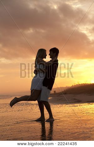 Young Couple at the Beach at Sunset