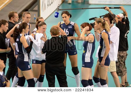DEBRECEN, HUNGARY - JULY 8: Israeli players listen to their trainer at a CEV European League woman's volleyball game Hungary (Red) vs Israel (Blue) on July 8, 2011 in Debrecen, Hungary.