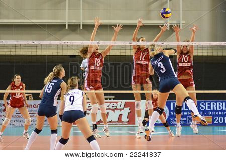 DEBRECEN, HUNGARY - JULY 8: Dora Horvath (in red 10) in action at a CEV European League woman's volleyball game Hungary (Red) vs Israel (Blue) on July 8, 2011 in Debrecen, Hungary.