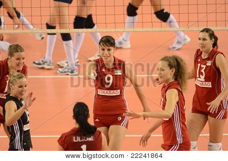 DEBRECEN, HUNGARY - JULY 8: Hungarian players celebrate at a CEV European League woman's volleyball game Hungary (Red) vs Israel (Blue) on July 8, 2011 in Debrecen, Hungary.