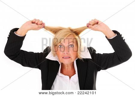 A portrait of a mature frustrated woman pulling out hair over white background