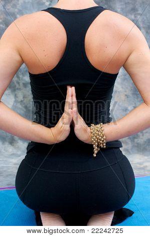 Young Woman In Yoga Virasana  Or Hero Pose With Reverse Prayer