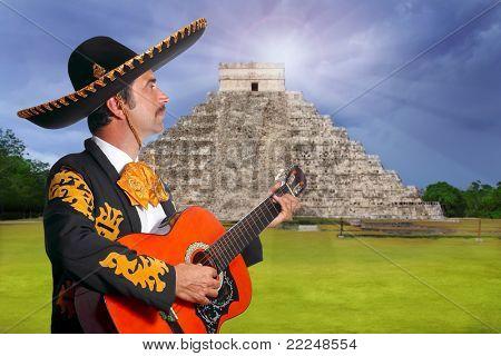 Charro Mariachi playing guitar in Chichen Itza pyramid Mexico