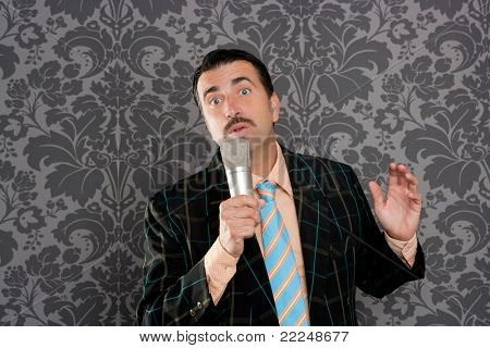 retro mustache singer man tacky suit on vintage wallpaper background