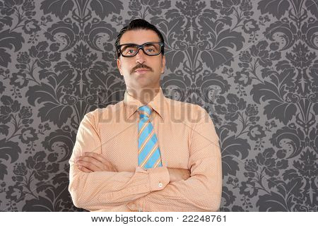 businessman nerd portrait with retro glasses over wallpaper background